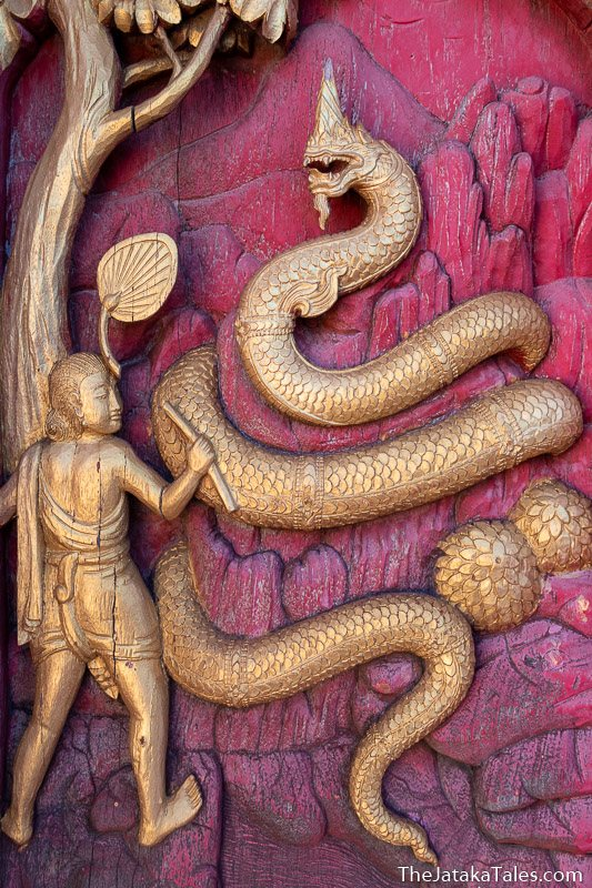woodcarving of naga coiled around an anthill